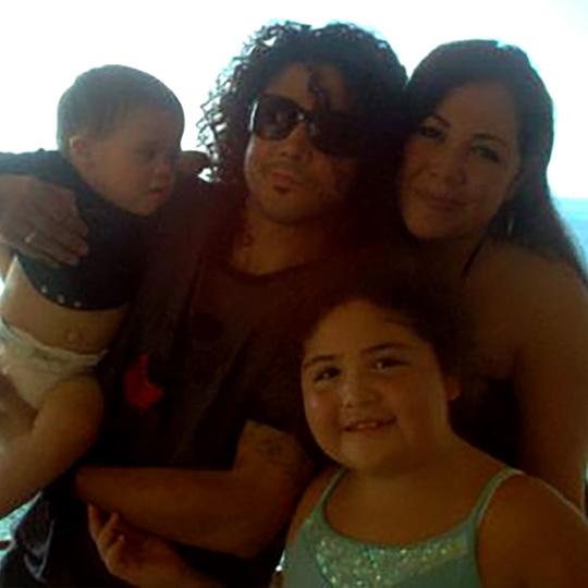 Vanessa Villanueva and Chris Perez with their kids.