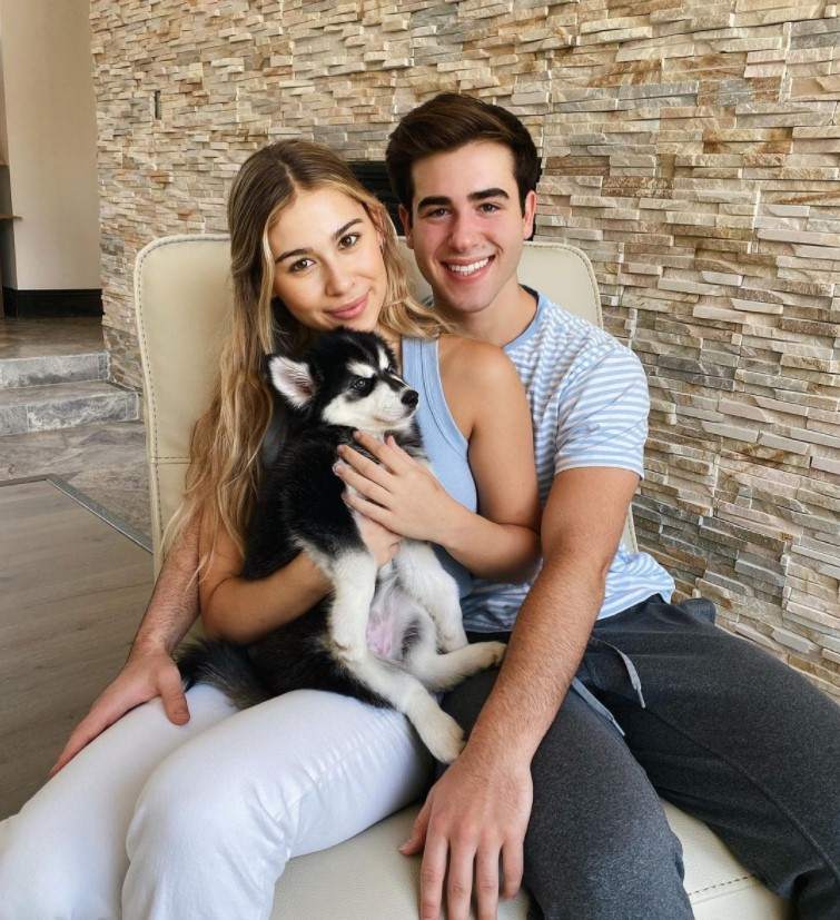 Adi Fishman alongside his girlfriend Emily Michelle Alexander and their pet dog