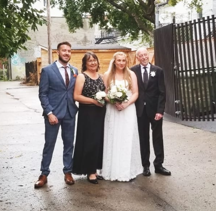 Ryan George alongside his sister and parents in his sister's wedding
